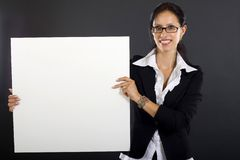 Attractive businesswoman presenting a blank board Royalty Free Stock Photo
