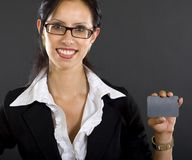 Attractive businesswoman presenting a blank card Royalty Free Stock Photos