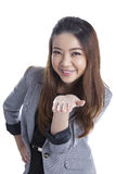 Attractive businesswoman presenting something on the palm of her Royalty Free Stock Image