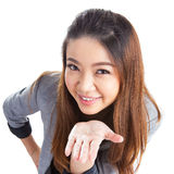 Attractive businesswoman presenting something on the palm of her Stock Photos