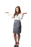Attractive businesswoman presenting something on the palm of her Royalty Free Stock Photo