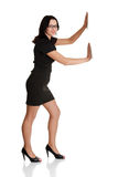 Attractive businesswoman push imaginary wall Royalty Free Stock Image