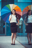 Attractive Businesswoman with rainbow umbrella Royalty Free Stock Image