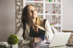 Attractive businesswoman reading book Stock Photography