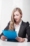 Attractive businesswoman reading her notes Stock Photos