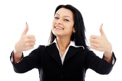 Attractive businesswoman showing thumbs up sign Stock Images