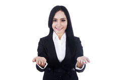 Attractive businesswoman shows your product Royalty Free Stock Image