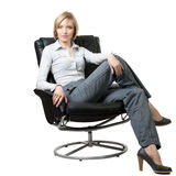 Attractive businesswoman sitting in the armchair Royalty Free Stock Image