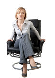 Attractive businesswoman sitting in the armchair Royalty Free Stock Photography