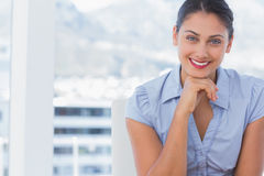 Attractive businesswoman sitting at her desk Stock Photography