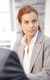 Attractive businesswoman sitting in office Royalty Free Stock Photography