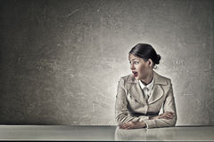 Attractive businesswoman sitting at table Royalty Free Stock Photography