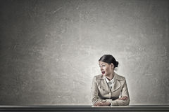 Attractive businesswoman sitting at table Stock Photography