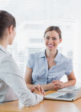 Attractive businesswoman smiling at camera with her colleague Stock Photography