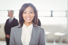 Attractive businesswoman smiling at camera Stock Images
