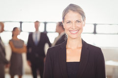 Attractive businesswoman smiling at camera Royalty Free Stock Photos
