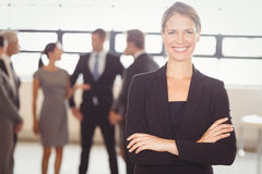 Attractive businesswoman smiling at camera Stock Photo