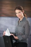 Attractive businesswoman smiling happily Royalty Free Stock Image