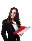 Attractive businesswoman. Smiling and holding a folder over a white background Stock Image