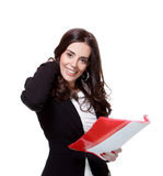 Attractive businesswoman. Smiling and holding a folder over a white background Royalty Free Stock Photo