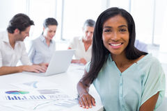 Attractive businesswoman smiling in the workplace Royalty Free Stock Images