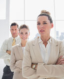 Attractive businesswoman standing with arms crossed Royalty Free Stock Photography