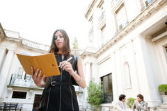 Businesswoman with folder. Royalty Free Stock Photography