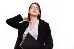 Attractive businesswoman / student holding her hair in Studio Royalty Free Stock Photography