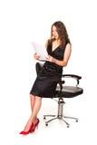 Attractive businesswoman studying paperwork Stock Photo