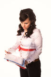 Attractive businesswoman studying paperwork Royalty Free Stock Images