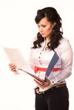 Attractive businesswoman studying paperwork Stock Image