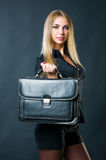 Attractive businesswoman with suitcase Stock Photo