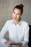 Attractive businesswoman with tablet smiling. Attractive businesswoman with tablet, red lips, in office Royalty Free Stock Photography
