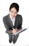 Attractive businesswoman taking notes Royalty Free Stock Images