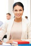 Attractive businesswoman taking notes in office Stock Photography