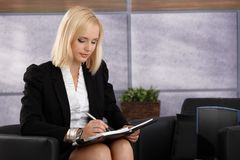 Attractive businesswoman taking notes Royalty Free Stock Image