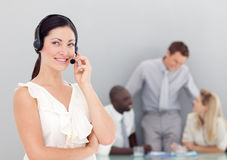 Attractive businesswoman talking on a headset Stock Photo