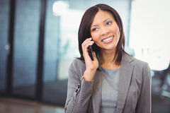 Attractive businesswoman talking on mobile phone Stock Photography