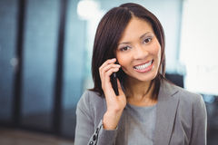 Attractive businesswoman talking on mobile phone Royalty Free Stock Images