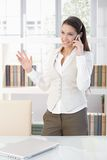 Attractive businesswoman talking on mobile smiling Royalty Free Stock Photo