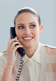 Attractive businesswoman talking on phone Stock Image
