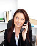 Attractive businesswoman talking on phone sitting Royalty Free Stock Photo