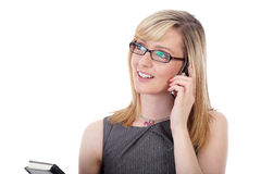 Attractive businesswoman talks over mobile phone Royalty Free Stock Photography