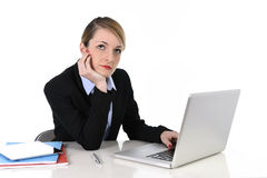 Attractive businesswoman thinking and looking distraught while working on computer Royalty Free Stock Photo