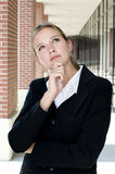 Attractive businesswoman in thoughtful pose Royalty Free Stock Images