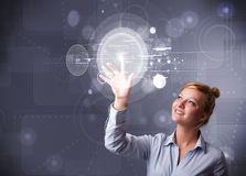 Attractive businesswoman touching abstract high technology circu Stock Image
