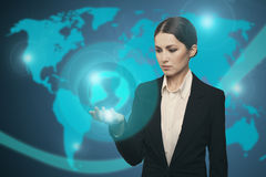 Attractive businesswoman touching icon of media earth Stock Photography