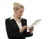 Attractive businesswoman typing on tablet computer Stock Image