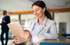 Free Attractive Businesswoman Using A Digital Tablet In Office Royalty Free Stock Photography - 217965087
