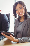 Attractive businesswoman using digital tablet Stock Photo